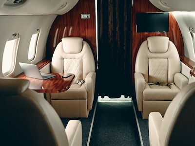 Business jet or private plane aircraft interior seating arrangement by high tech finishing in houston. texas.