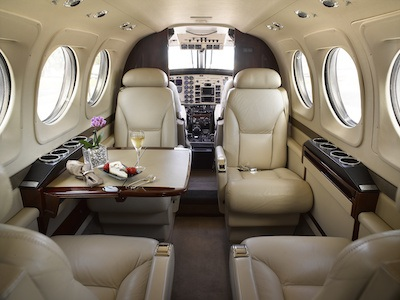 Aircraft interior of private jet including aircraft seat fabric and metal parts